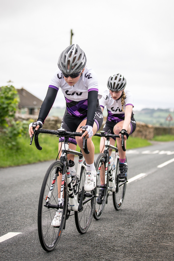Team work climbing the hills on outskirts of Lancaster during NW Tour road race