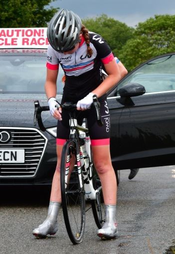 Hannah Graveney suffers puncture at Diss CC Summer Road Race (photo: John Orbea)