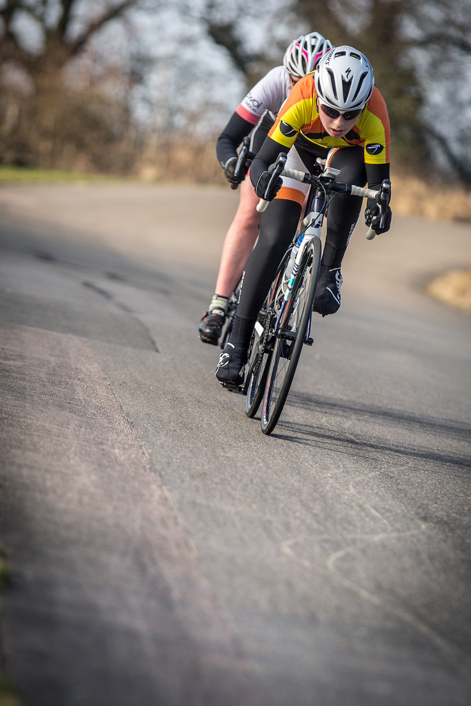 Eva Callinan being chased by new team mate Charlotte McGreevy (photo © Huw Williams)